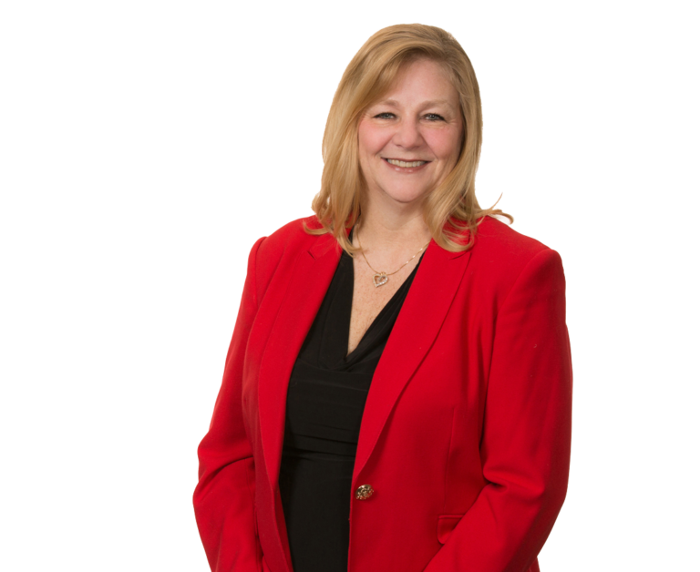 Terri Searle - a woman in a business jacket, smiling at the camera
